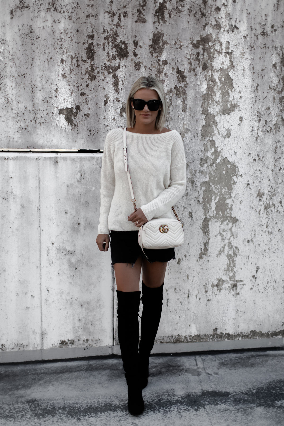 A cute cream sweater outfit on Sage Coralli of So Sage Blog