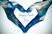 hands forming a heart patterned with a world map (furnished by NASA) and the text happy earth day