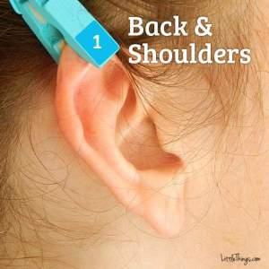 ryggen og skuldrene