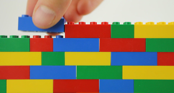 Hand building lego wall