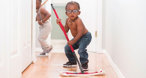 Boy mopping floor doing chores