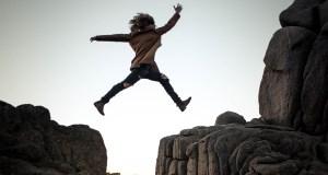 Jumping across rocks. Risk taking.