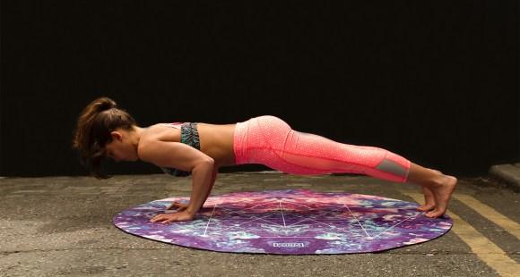 Woman doing pushups in Pilates class