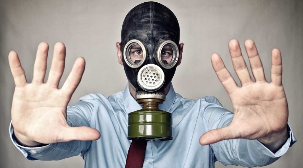 Business man with gas mask. Toxic behavior.