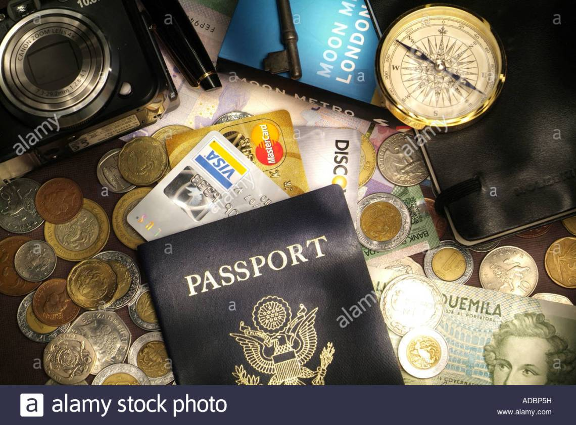 travel-money-and-credit-cards-concept-with-passport-foreign-currency-ADBP5H