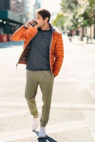 with-striped-shirt-beige-pants-and-white-sneakers