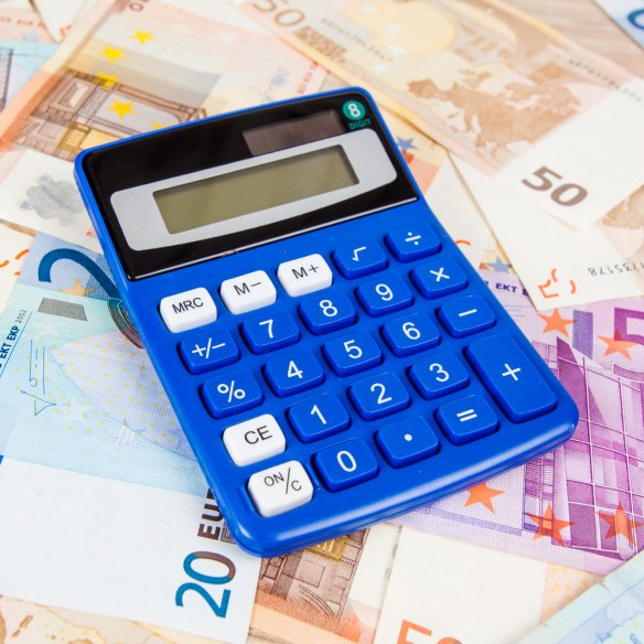 Financial concept. Euro money. Euro notes with calculator