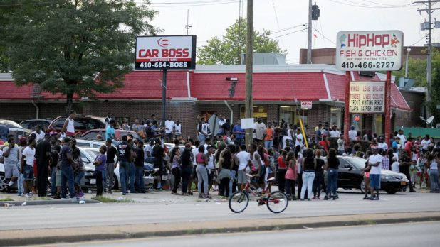 A crowd assembled as dirt bikers rode by on Reisterstown Road -- as they do every Sunday. Someone called police to report fighting in the crowd. When police moved in, they were pelted by rocks from the crowd. Subsequently, police donned riot gear. No one was injured; a dirt bike was confiscated.