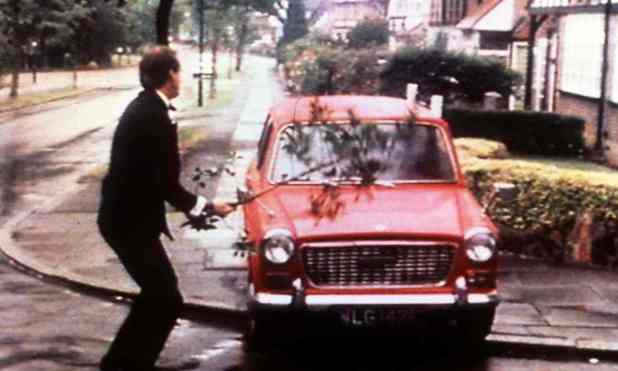 An enraged Basil Fawlty attacks his car with a branch. Photograph: BBC Picture Archive
