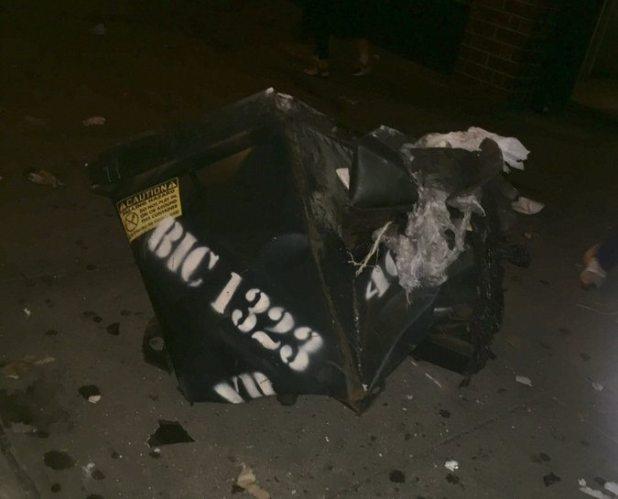 Witnesses said the blast on West 23rd Street had seemed to come from a Dumpster. The authorities were investigating the cause.