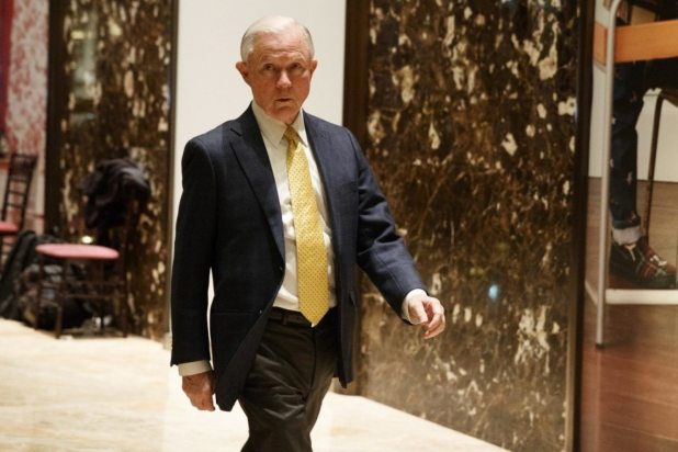Sen. Jeff Sessions, R-Ala., talks with reporters as he arrives at Trump Tower Monday. (AP Photo/ Evan Vucci)