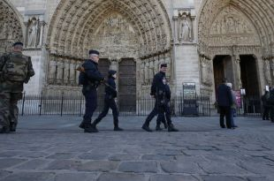 Man Shot Outside Notre Dame Cathedral After Attacking Police with Hammer, Paris Officials say