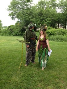 The Green man and woman reading an original blessing written for the occasion