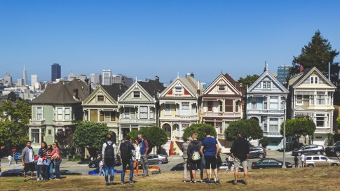 The iconic shot of San Francisco's Painted Ladies, Victorian houses fronting a view of downtown.