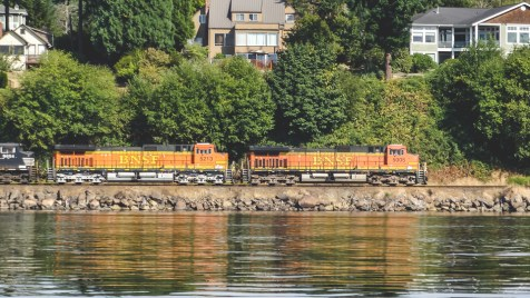 Freight train speeding along the edge of Puget Sound south from Seattle toward Olympia and beyond
