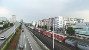 Modern condos, freight rail, freeway into downtown Tacoma