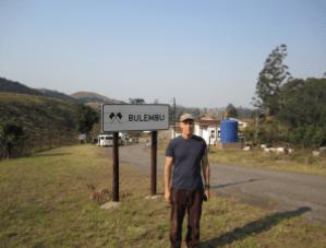 John beside Bulembu town sign