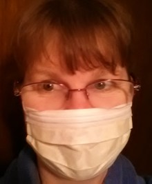 That would be me.... and, yes, I am smiling behind the mask.