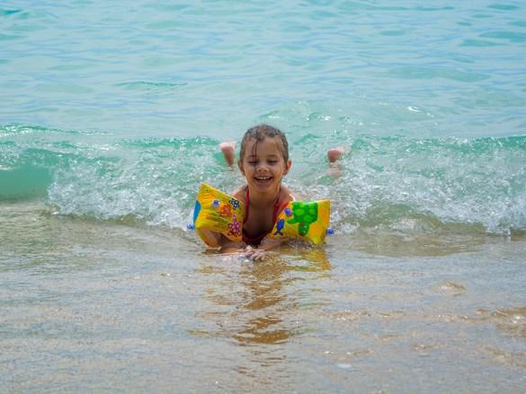 Child swims in the sea