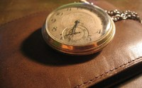 Time & Money: Photo of a pocketwatch on a wallet