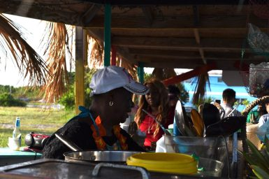 Tryphena Knowles serves conch salad at The Divas Spot