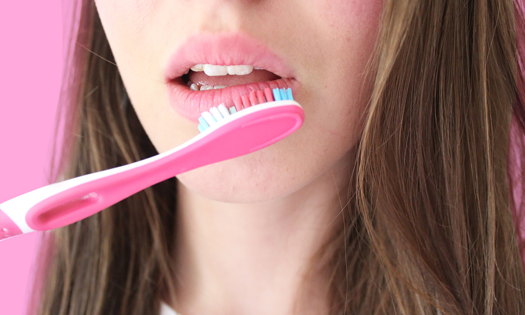 exfoliating with toothbrush
