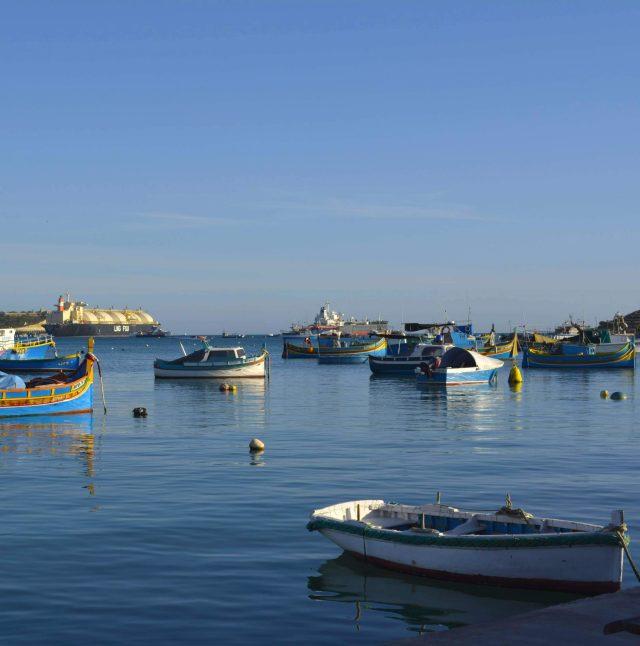 Maltese luzzu boats docked at port