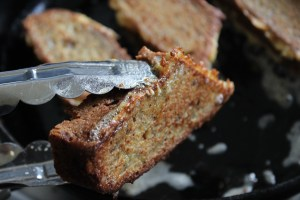 Add a cube of butter and a little oil to fry pan. Brown soaked banana bread for 2 minutes each side.