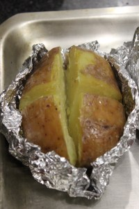 Cut a cross int the top of the potato and spread open slightly.