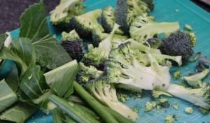 Prep green vegetable for sautéing.
