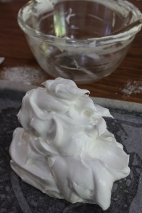 Spoon meringue onto baking paper lined tray. Try to make it stay in the centre.