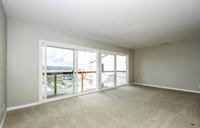 Living room with balcony and unobstructed views