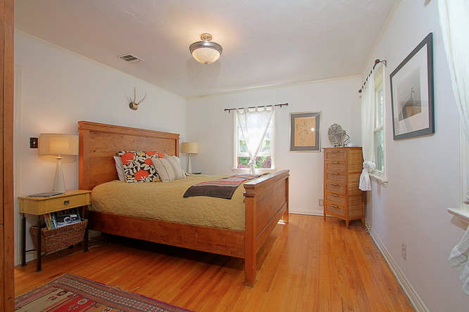 Bedroom with original wood floors