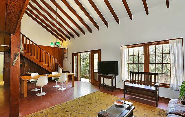 Open floor plan and vaulted/beamed ceiling