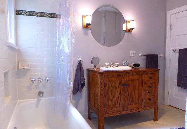 Bath with custom oak vanity and original cast iron tub