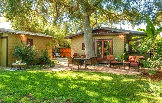 Spacious backyard with storybook tree