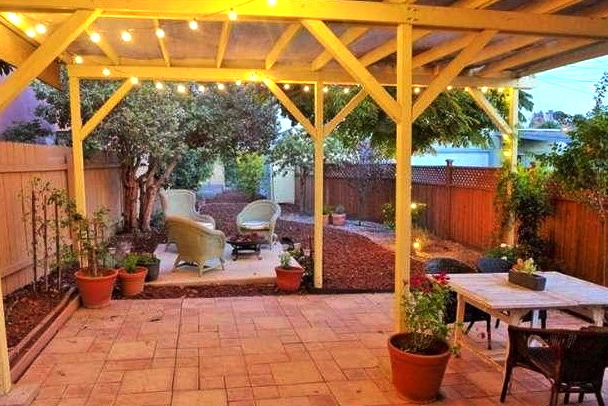 Patio and yard. Courtesy of Nancy Marfisi – Sotheby's Int'l Realty