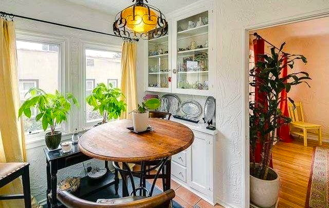 Breakfast nook with original built-in cabinet