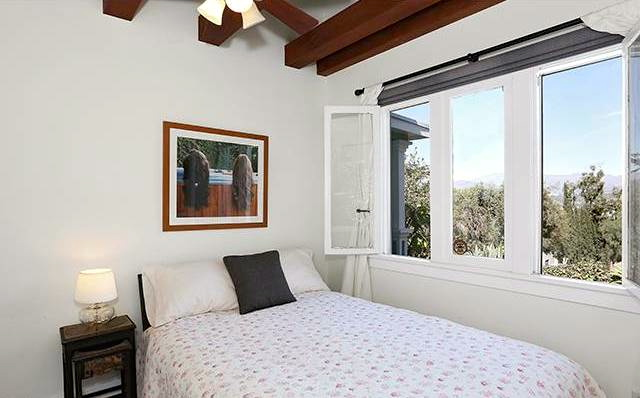 Bedroom with beamed ceilings and views