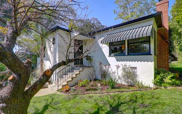 Perched on a lush knoll in Verdugo Village