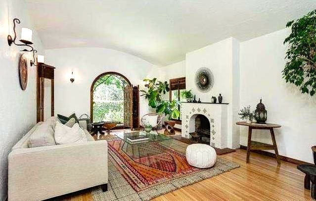 Living room with original wood floors, picture window and fireplace