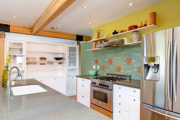 Kitchen with Bertazzoni range, custom cabinets and Heath tile backsplash