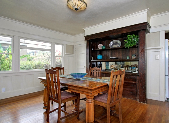 Original wood floors and vintage sideboard
