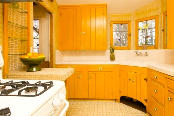 Vintage kitchen with built-in cabinets and leaded glass windows