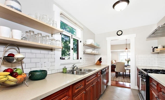 Updated galley kitchen with open shelves
