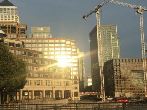 Reflection of sun setting, Canary Riverside, London, UK. Taken by Peter Thompson