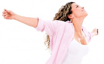 woman happily coached by intuitive spiritual counselor