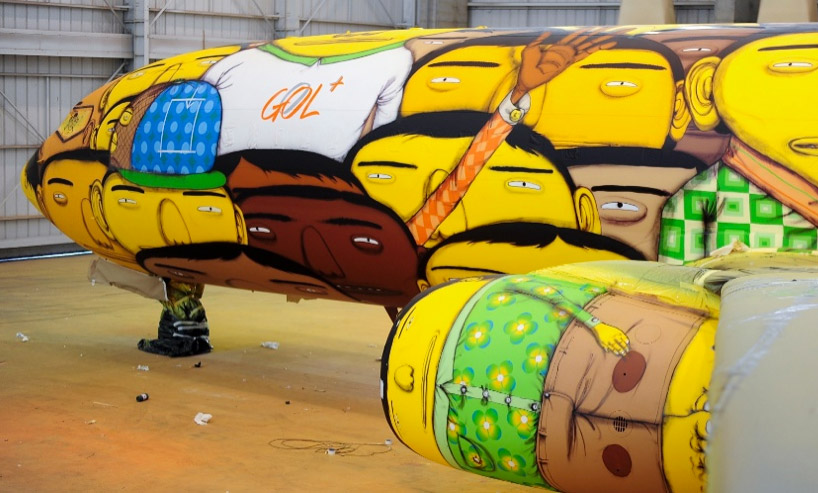 os gemeos graffitis boeing 737 for team brazil's FIFA world cup travel