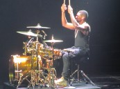 Usher drumming . . . with his shirt on.