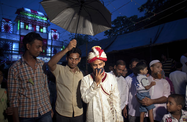 """MANIKGANJ, BANGLADESH - AUGUST 20: 32 year old Mohammad Hasamur Rahman arrives to his wedding venue on the day that he will marry 15 year old Nasoin Akhter August 20, 2015 in Manikganj, Bangladesh.  In June of this year, Human Rights Watch released a damning report about child marriage in Bangladesh. The country has one of the highest rates of child marriage in the world, with 29% of girls marrying before the age of 15, and 65% of girls marrying before they turn 18. The detrimental effects of early marriage on a girl cannot be overstated. Most young brides drop out of school. Pregnant girls from 15-20 are twice as likely to die in childbirth than those 20 or older, while girls under 15 are at five times the risk. Research cites spousal age difference as a significant risk factor for violence and sexual abuse. Child marriage is attributed to both cultural tradition and poverty. Parents believe that it """"protects"""" girls from sexual assault and harassment. Larger  dowries are not required for young girls, and economically, women's earnings are insignificant as compared to men's. (Photo by Allison Joyce/Getty Images)"""